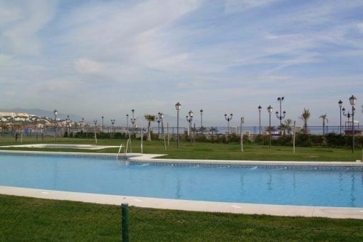 The spacious community pool with magnificent views to the sea