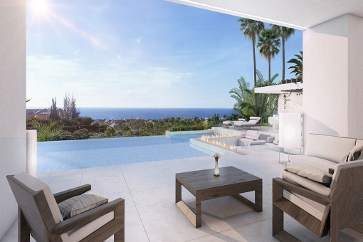 The cosy pool area with lounge and sea views