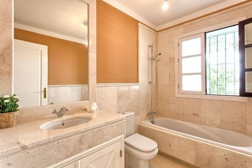 Another bathroom en suite with washbasin