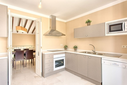 The open plan kitchen with oven and cooking area