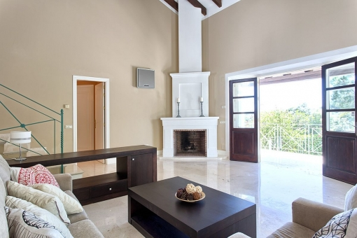 The living area offers a fireplace with access to the balcony