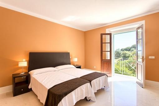 The master bedroom with bathroom en suite