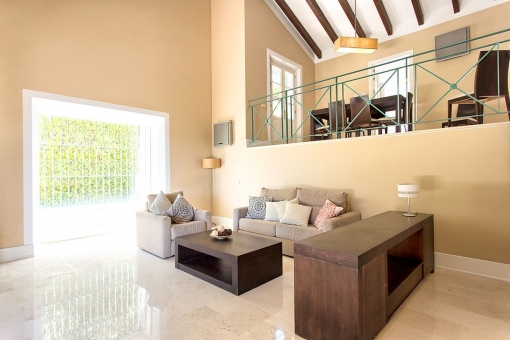 The bright living area with lounge