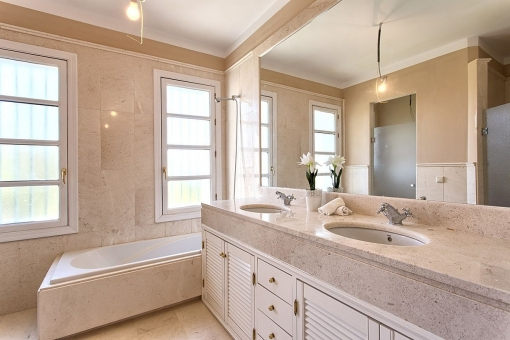 Tasteful bathroom with window