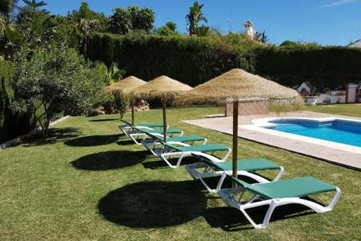 Large pool area with sunbeds