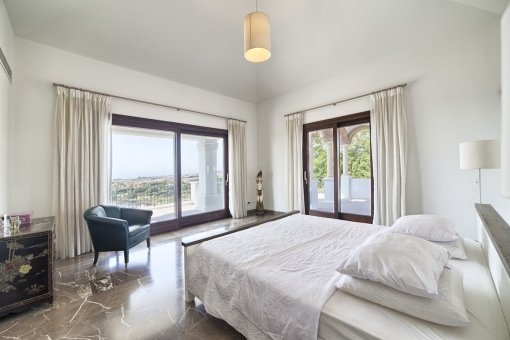 Noble master bedroom with sea views