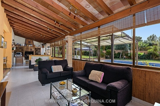 Covered terrace with fireplace