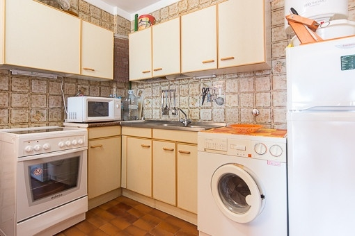 Small kitchen with laundry