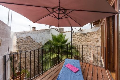 Shady terrace on the upper floor