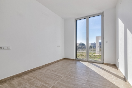 Bright bedroom with floor-to-ceiling window