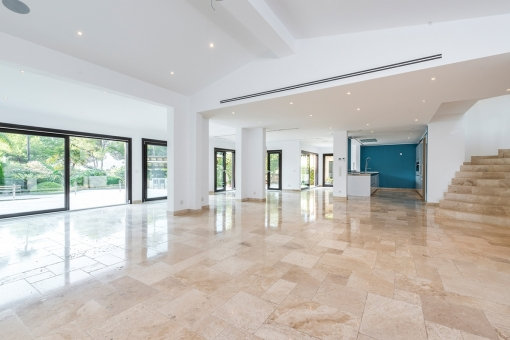 The impressive living and dining area is very light-flooded