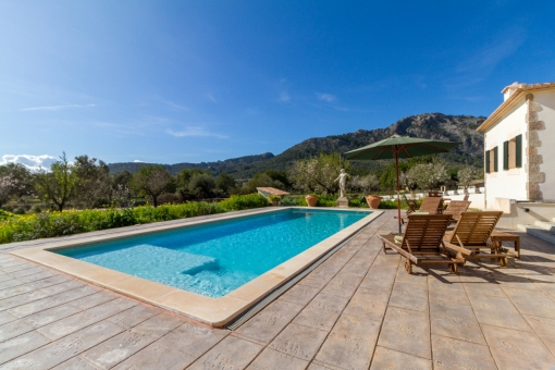 Large pool area with sunloungers