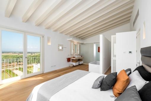 Bright bedroom with open bathroom