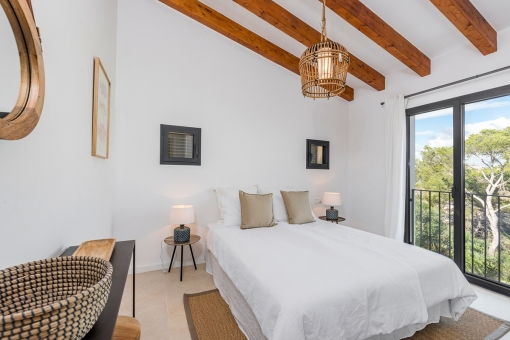 Master bedroom with wooden beams