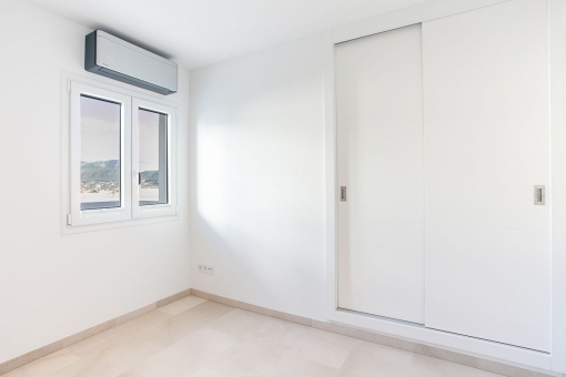 Bedroom with built-in wardrobes