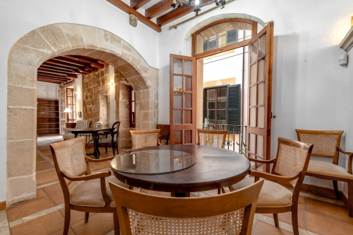 Dining area with original stone arch