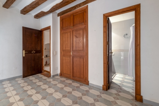 Bedroom with beautifully tiled floor