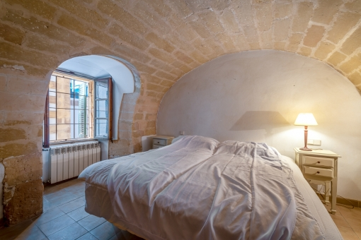 Bedroom with vaulted stone ceiling