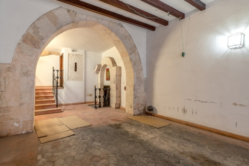 Lower floor with impressive stone arch