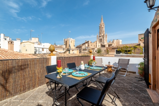 Renovated old-town house in a prime location in Palma with a restaurant on the ground and mid-level and a duplex apartment with roof terrace above