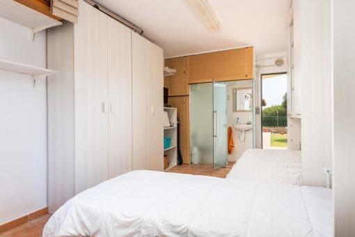 Separate bedroom with bathroom