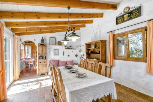 Rustic dining area with access to the terrace