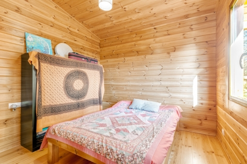 Lovely bedroom with wooden planks