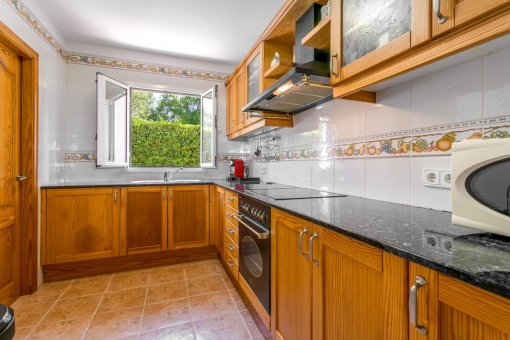 Fully equipped, wooden kitchen