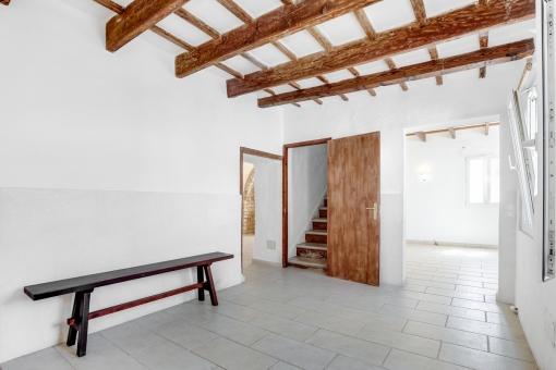 Room with wooden ceilings beams