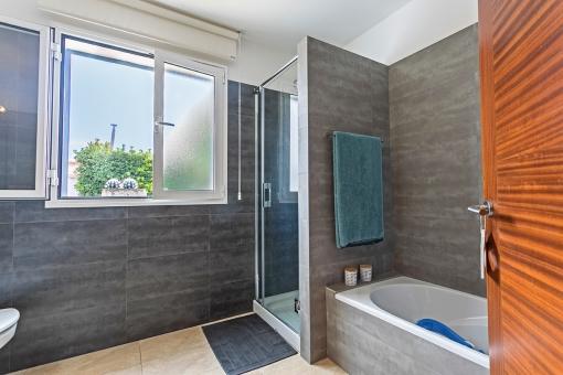 Modern bathroom with bathtub and shower