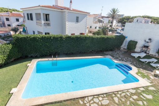 Four lovely apartments with garden and pool near to the beach of Arenal d'en Castell with touristic rental licence