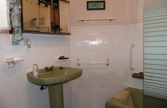 Bathroom with tub and built in shower