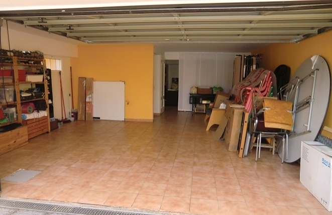 Very large garage with storage space