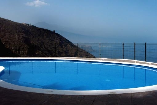 Community pool with sea view