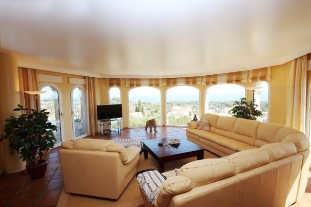 The exquisite living room with huge windows and spectacular views
